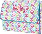 "Peace Computer Sleeve $20.95 Peace Computer Sleeve  16"" L x 2"" W x 11"" H  Polyester  Inside Zipper Pocket  Padded for Extra Protection  Snap Closure"