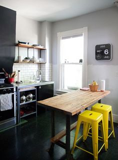 I love the yellow stools! Incorporate a small dining area in the kitchen for small homes and apartments!