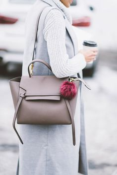 Grey sweater, grey vest, a Céline bag, and a pouf keychain. Dreamiest look ever!