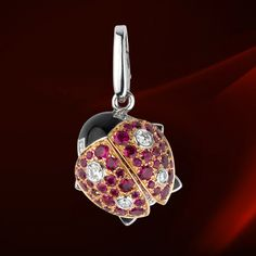 Cartier ladybird charm.  White gold, diamonds, rubellites, lacquer  #jewellery #jewelry #charms