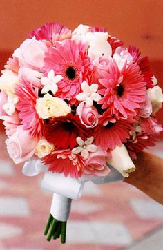 LOVE this bouquet!  Not quite as formal as I imagined I wanted but I'm thinking this could be it...