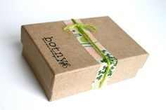 Super cute packaging: brown kraft box with washi tape and simple yarn, via Etsy.