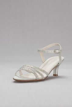 """Add a touch of sparkle to your look with these low-heel, quarter-strap sandals, finished in tiny rhinestones.  Synthetic  2.5"""" heel  Adjustable buckle  Imported"""