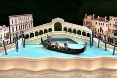 "By Mike's Amazing Cakes :: ""This wedding cake represents the couples time in Venice. There's cake in the Rialto bridge and the sheet cake it sits on. We cut the sides at angles to create some forced perspective. To better fit the couples budget, we created edible image backdrops of the homes along that canal. I would have loved to make the buildings dimensional but that proved to be too costly."""