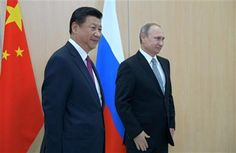 Russian President Vladimir Putin, right, and Chinese President Xi Jinping, left, pose for a photo prior their talks during the summit in Ufa, Russia, Wednesday, July 8, 2015. (Host photo agency/RIA Novosti Pool Photo via AP) ▼8Jul2015AP Putin: Russia and China can overcome any difficulty together http://bigstory.ap.org/article/7eb452fde0824f78ab3866c37adb4ab3