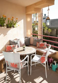 Balcony furnishings terrace design round table rattan chairs seat tulips
