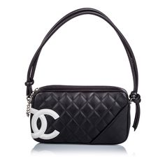 The Chanel Cambon Ligne Pochette Black Lambskin Leather Baguette is a top 10 member favorite on Tradesy. Vintage Chanel Bag, Chanel Purse, Chanel Handbags, Designer Handbags, Designer Bags, Luxury Purses, Luxury Bags, Best Handbags, Purses And Handbags