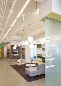 Raw elements, polished concrete floors and an exposed deck, are juxtaposed with bright white walls and ceilings. High Ceiling Lighting, Open Ceiling, White Ceiling, White Walls, Corporate Office Design, Office Interior Design, Exposed Ceilings, High Ceilings, Commercial Office Design