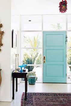 Try turquoise! After all, it's the trendiest color this year! Photo: Domino magazine      The Look: The flip side of an exterior door is painted a bright, cheery turquoise to give guests a colorful farewell at the end of the night. Surrounded by white walls and flooring, the turquoise is just the pop of color this entryway needs! Don't be afraid to paint a door one color on the outside and another on the inside -- just be sure that they match and that you're tidy with your paint lines!    The Co