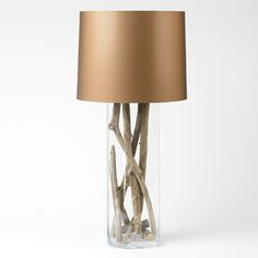 .Bringing outdoors inside...glass based lamps often hold seashells, this one holds driftwood...beautiful!