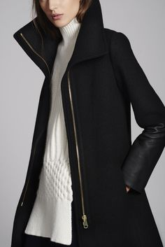 Speak volumes in a leather-trimmed coat with enveloping collar.