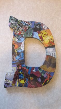 """Large 8-9"""" letter - custom order hand decorated made with real comic books - lots of Marvel and DC characters available. $11.99, via Etsy."""