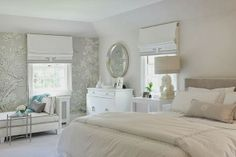 pretty silver, white and blue master bedroom with upholstered headboard and white bedroom bench