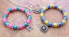Pretty Lily And Sunflower Springtime Jewellery Sets - Includes Necklace and Bracelet - They Will Match Frozen Fever Dresses by FairyFountainGifts on Etsy https://www.etsy.com/listing/228510550/pretty-lily-and-sunflower-springtime