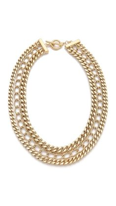A trio of shining gold-tone chains create a lavishly layered look on this Adia Kibur necklace. Ring-and-toggle clasp.