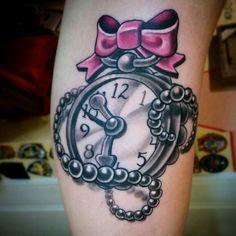 Pretty girly pocket watch with bow done by Veronica Dey tattoo. New school tattoo.  Www.veronicadeytattoo.com