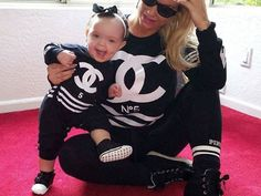Coco and Baby Chanel Nicole Wear Matching Chanel-Inspired Looks Ahead of the Holidays<br />Talk about twinning!<br /><br />Coco and her adorable daughter Chanel are getting ready for the holidays by doing what they do best...wearing matching outfits! The reality TV star and her daughter dressed in the same black Chanel No. 5 shirts and pants, which of course is a shout out to baby Chanel Nicole's namesake Coco Chanel. Ice-T and Coco's daughter is made even cuter by the large grin on her face…