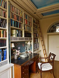 Office space with bookshelves, ladder - Max Rollitt in London