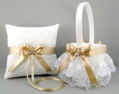 Customize your wedding with this beautiful champagne on white or ivory satin and embroidered lace flower girl basket and ring bearer pillow set.  The ivory or white satin basket features two tiered rows of a pretty ruffled embroidered lace. The top of the basket is trimmed in ribbon,