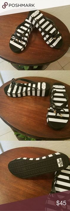 """Brand New Kate Spade B&W striped wedge sandals Adorable flip flops with 1 3/4"""" heel . Brand new, flawless condition kate spade Shoes Flats & Loafers"""