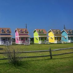 Beach houses in the Outer Banks. I want the green one. And i will be next door in the pink one but is really like purple
