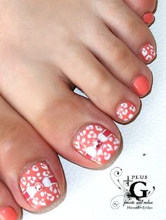 cute pedicure toe nail art. coral colors w/ ribbon & leopard print-ish design