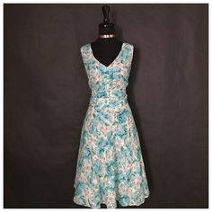 This is a lovely Amanda Lane brand floral dress. It has a vintage inspired look with floral designs through out. It has a v-neck line, a back zipper, is sleeveless and is knee length.     The dress is a size 16P with the following measurements:    MEASUREMENTS    - Length: 43 1/2 inches    - Bust: 41 inches    - Waist: 36 inches | Shop this product here: http://spreesy.com/UyleesBoutique/806 | Shop all of our products at http://spreesy.com/UyleesBoutique    | Pinterest selling powered by…