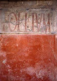 """Pompeii / Inscription: """"Olium"""" on the store of an oil dealer."""