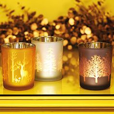 Create Holiday Romance. Silver-plated within and etched in frosted glass without, the pristine images of these Winter Tree Votives cast picturesque shadows when the candles they hold are illuminated.