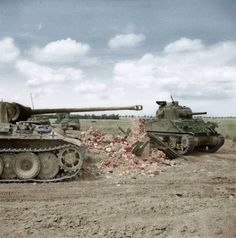 A Sherman tank of 24th Lancers, 8th Armoured Brigade, passing a knocked-out German PzKpfw V Panther #204 of 2.Kompanie/SS-Panzer-Regiment 12, 12th SS-HJ near Rauray, Normandy. (Colorized by Gabriel Bîrsanu)
