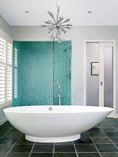 This modern bathroom keeps fixtures and finishes to a minimum.