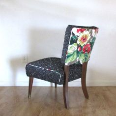 Mid-century slipper chair reupholstered in bouclé with floral barkcloth piping and back.