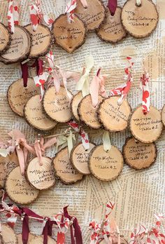 Hand-written wood rounds make for super-festive escort cards | Brides.com wedding place cards, sports wedding place cards #wedding #weddings