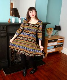 Yes, this is from a sewing blog, but I LOVE that sideboard in the corner!