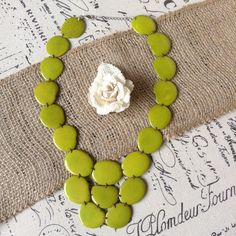APPLE GREEN NECKLACE MADE OF ECO FRIENDLY TAGUA  This tagua necklace has been made of thin slices of Tagua nut, an Eco friendly material, found in South America. This necklace is sure to make an statement! Even though is chunky, its very lightweight, thus comfortable to wear, at the same time its very resistant. Each Tagua slice is unique due to the natural origin of this organic material.  Each bead on this necklace is approximately 1.25 inches wide (3 cmts) and 1 inch long ( 2 1/2 cmts)…