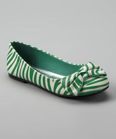 These sweet shoes add a touch of elegance to a little lady's ensemble. With bows by the toes and allover.