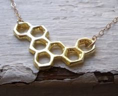 you could totally do this yourself by spray painting a bunch of little washers gold and gluing them together.