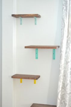 Cat Food - To replace our bulky cat tower, I built these colorful cat shelves for the living room. Diy Cat Shelves, Corner Shelves, Cat Climbing Wall, Cat Climbing Shelves, Benadryl For Cats, Cat Safe Plants, Cat Hacks, Cat Towers, Cat Room