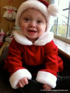 Josie in the Christmas outfit she got for her birthday
