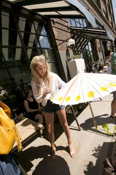 Outside at a mini market, guests could design their own parasols to take along to the festival on the hot, sunny day.  Photo: Courtesy of SoHo House Chicago