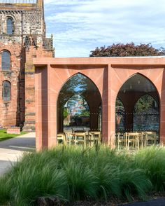 Feilden Fowles has refurbished the medieval dining hall at Carlisle Cathedral in north-west England and extended it with a red sandstone entrance pavilion.