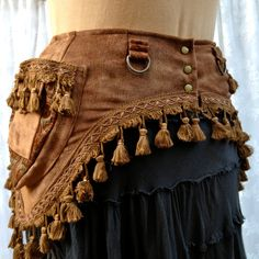 Steampunk costume belt - fancy toolbelt - brown with tassels - size Medium. $120.00, via Etsy. This US lass has some fab festy belts :)
