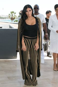 """Pin for Later: We Think You're Going to Like Kim Kardashian's Latest Look  Kim styled her Fall 2015 Balmain set with her dainty """"Nori"""" necklace, her engagement ring, and simple black sandals."""