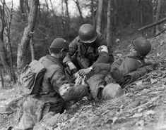 vintage everyday: Rare Images of the Battle of the Bulge - WWII Tending to the wounded in the Ardennes