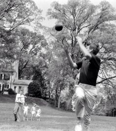 Jack Kennedy throws a pass to Bobby as they play football on the lawn at Hickory Hill, Bobby's home in Virginia, in 1957.