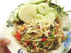 Som Tum (Spicy Papaya) Salad. I search for the same version as in Thailand but it is a rarity here.