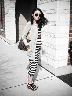 Those maxi-dresses? Your best friends! Layering a jacket (sweater or blazer) adds structure and form.