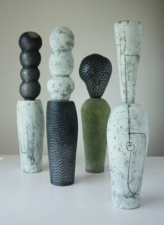 Daphne Corregan | Carriers, 37 in. (94 cm) in height, stoneware, raku, and smoked clay, 2009.