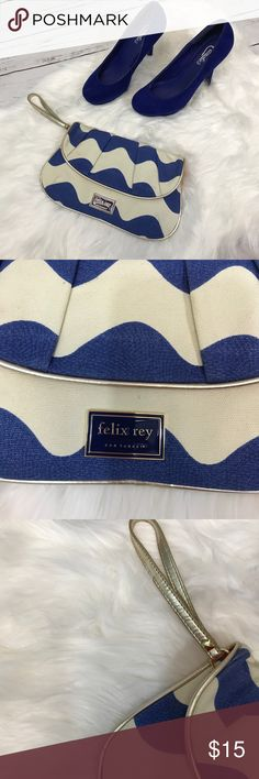 "Felix Rey for target blue and white clutch Felix Rey for target blue and white clutch.   Gold strap and accents.   Minor marks under flap which cannot be seen when closed (picture 4).  Other than that, excellent condition.  11"" at longest point, 6"" tall.  *Descriptions are described to best ability but please do not hesitate to ask questions if more information is needed. Colors may vary slightly to lighting and photos.* Felix Rey for Target Bags Clutches & Wristlets"