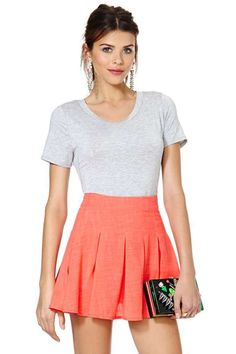 Cheer up in one of our favorite Nasty Gal designs! This skirt has all-over box pleating, a high-waisted silhouette, and comes in a head-turning shade of red.